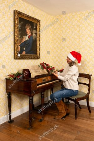 Stock Image of Collections manager Sophie Reynolds lays down a Christmas garland on the mantlepiece in the dining parlour as part of the Christmas experience as the Jane Austen's House Museum prepares to reopen to the public for the second time this year.   Dame Emma Thompson has come to the aid of Jane Austen's former home by providing the voice to a new online Christmas experience.  From today fans of the novelist can hear the actor - who won an Oscar for her screenplay for the 1995 film adaptation Sense and Sensibility - read from some of her books and letters.  The 61 year old has recorded eight tracks for the Jane Austen House museum, which showcase her 'dry wit and enjoyment' of yuletide traditions.  This week staff at the House in Chawton, Hants, have been putting up Christmas decorations in the hope that they will be able to reopen on December 3 if restrictions are eased, so visitors can enjoy the experience first hand.