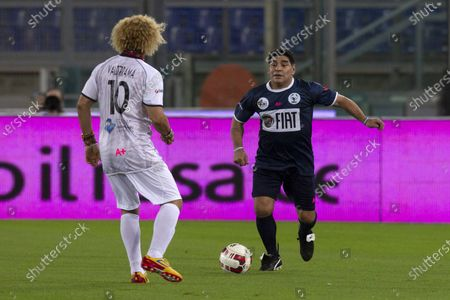 "Diego Maradona and Carlos Valderrama during the charity game ""Match4Peace"" at the Stadio Olimpico in Rome"