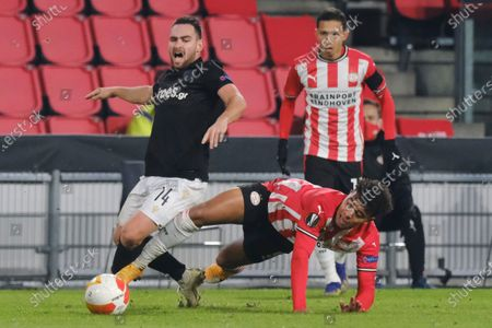 PAOK's Andrija Zivkovic, left, and PSV's Donyell Malen vie for the ball during the Group E Europa League soccer match between PSV and PAOK at the Philips stadium in Eindhoven, Netherlands