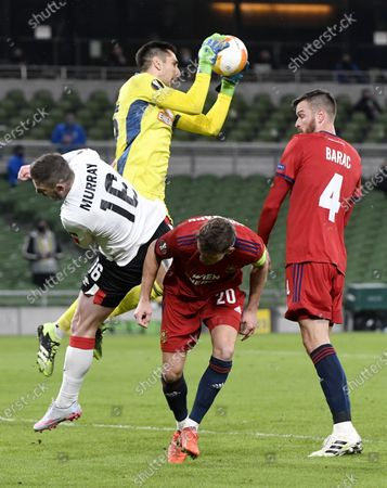 Stock Photo of Goalkeeper Paul Gartler (C) of Rapid catches the ball in front Sean Murray (L) of Dundalk during the UEFA Europa League Group B match between Dundalk and Rapid Vienna in Dublin, Ireland, 26 November 2020.