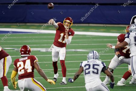 Washington Football Team quarterback Alex Smith (11) throws a pass to running back Antonio Gibson (24) as Dallas Cowboys safety Xavier Woods (25) defends in the second half of an NFL football game in Arlington, Texas