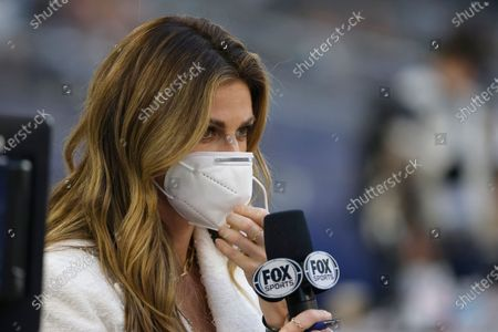Sideline reporter for Fox Sports Erin Andrews prepares to broadcast before the Dallas Cowboys play the Washington Football Team in an NFL football game in Arlington, Texas