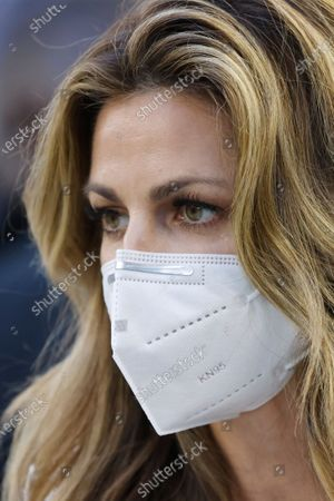 Stock Picture of Sideline reporter for Fox Sports Erin Andrews prepares to broadcast before the Dallas Cowboys play the Washington Football Team in an NFL football game in Arlington, Texas