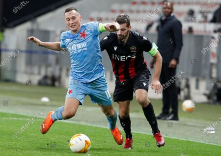 Jan Boril of Slavia Prague (L) in action against Morgan Schneiderlin of OGC Nice (R) during the UEFA Europa League Group C soccer match between OGC Nice and SK Slavia Prague, at the Allianz Riviera stadium, in Nice, France, 26 November 2020.