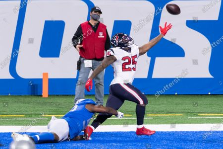 Stock Image of DETROIT, MI - : Houston Texans RB Duke Johnson (25) cannot reach the pass as Detroit Lions LB Reggie Ragland (59) makes contact prematurely during NFL game between Houston Texans and Detroit Lions on at Ford Field in Detroit, MI
