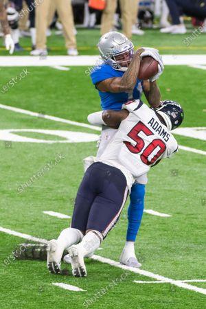 DETROIT, MI - : Detroit Lions WR Marvin Jones Jr. (11) makes a catch despite tight coverage by Houston Texans LB Tyrell Adams (50) during NFL game between Houston Texans and Detroit Lions on at Ford Field in Detroit, MI