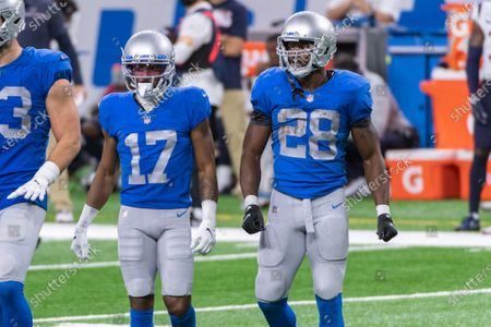 DETROIT, MI - : Detroit Lions RB Adrian Peterson (28) and Detroit Lions WR Marvin Hall (17) come back to the huddle following a play during NFL game between Houston Texans and Detroit Lions on at Ford Field in Detroit, MI