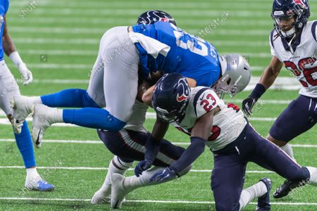 DETROIT, MI - : Detroit Lions TE Jesse James (83) gets upended by Houston Texans S Eric Murray (23) during NFL game between Houston Texans and Detroit Lions on at Ford Field in Detroit, MI