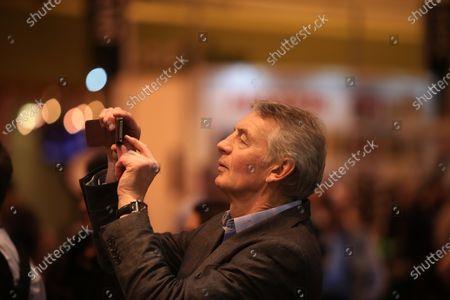 Autosport International Show NEC, Birmingham.  Friday 10 January 2014. Tony Jardine takes a photo of Walter Rohrl on the stage. World Copyright:Malcolm Griffiths/LAT Photographic