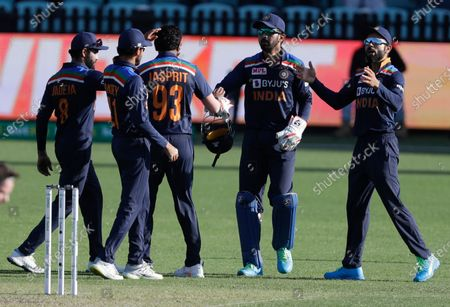 India's Jasprit Bumrah, centre, is congratulated by teammates after taking the wicket of Australia's Aaron Finch during the one day international cricket match between India and Australia at the Sydney Cricket Ground in Sydney, Australia