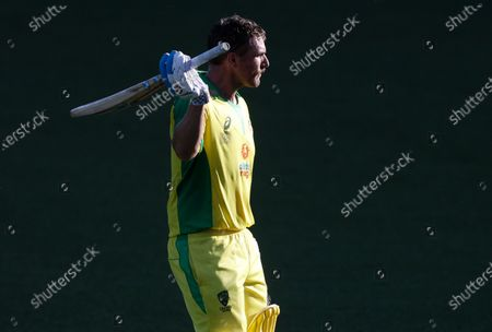 Australia's Aaron Finch waves to the crowd as he leaves the field after he was dismissed for 114 runs during the one day international cricket match between India and Australia at the Sydney Cricket Ground in Sydney, Australia