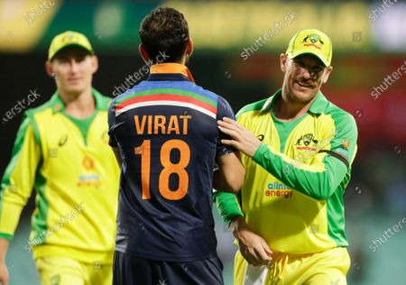 India's Virat Kohli congratulates Australia's Aaron Finch, right, after the one day international cricket match between India and Australia at the Sydney Cricket Ground in Sydney, Australia, .Australia defeated India by 66 runs