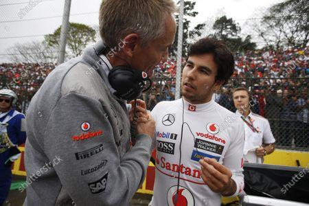 Interlagos, Sao Paulo, Brazil. Sunday 24th November 2013.  Martin Whitmarsh, Team Principal, McLaren, wishes good luck to Sergio Perez, McLaren, on the grid ahead of his final race for McLaren. World Copyright: Steven Tee/LAT Photographic.