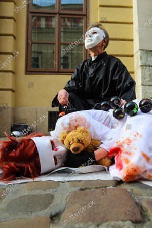 Protesters wearing white masks covered with fake blood symbolising the suffering of the victims take part during the demonstration. Activists protested on Kanoniczna Street in Cracow. The protest was an aftermath of a recently released reportage 'Don Stanislao. The second face of cardinal Dziwisz' that indicated that cardinal Dziwisz, long-time aide of pope John Paul II, could be responsible for covering up cases of pedophilia among catholic priests. People gathered on the street demanding explanations from the church and expressed support for the victims of pedophilia.