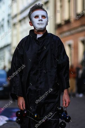 A protester wearing a white mask covered with fake blood symbolising the suffering of the victims takea part during the demonstration. Activists protested on Kanoniczna Street in Cracow. The protest was an aftermath of a recently released reportage 'Don Stanislao. The second face of cardinal Dziwisz' that indicated that cardinal Dziwisz, long-time aide of pope John Paul II, could be responsible for covering up cases of pedophilia among catholic priests. People gathered on the street demanding explanations from the church and expressed support for the victims of pedophilia.