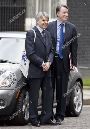 Lord Drayson and Lord Peter Mandelson in Downing Street with an Electric powered Mini (Mini E), London, Britain