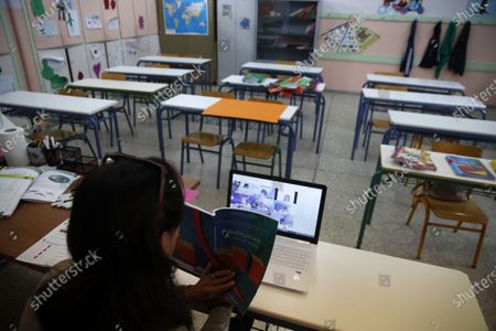 Teacher Aleka Michou gives an online lesson to C class students in an empty classroom of elementary school in Athens, . Most other European countries have vowed to keep schools open, but the pandemic has hit Greece hard for the first time in recent weeks following a successful lockdown in the spring, overwhelming hospitals in parts of the country. State television is making and broadcasting lessons, while teachers sit in empty classrooms talking to remote students. Despite some problems, they say it keeps children in touch with their schools