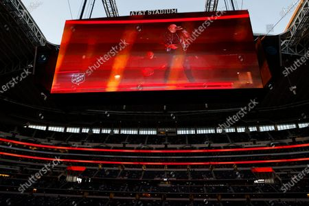 Pre-recorded musical performance by country singer Kane Brown is played on the video board for fans in attendance at AT&T Stadium during halftime of an NFL football game between the Washington Football Team and Dallas Cowboys in Arlington, Texas