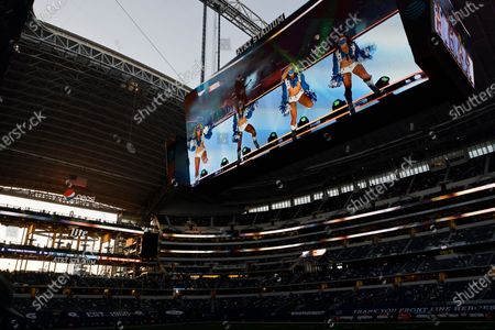 Stock Image of Pre-recorded musical performance by country singer Kane Brown is played on the video board for fans in attendance at AT&T Stadium during halftime of an NFL football game between the Washington Football Team and Dallas Cowboys in Arlington, Texas