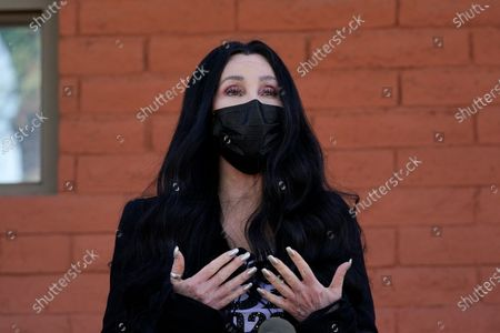 "Cher speaks near a polling station as she campaigns for Democratic presidential candidate Joe Biden, in Phoenix. Cher was set to visit Pakistan on to celebrate the departure of Kaavan, dubbed the ""world's loneliest elephant,"" who will leave his Pakistani zoo for better conditions after years of lobbying by animal rights groups and activists"