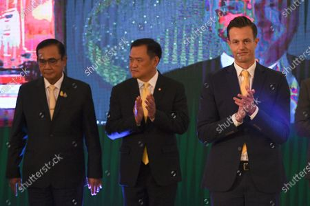 (L-R) Thailand Prime Minister Prayuth Chan-ocha, health minister Anutin Charnvirakul and President of AstraZeneca's in Thailand James Teague attend a signing ceremony agreement for Thailand to purchase of AstraZeneca's potential COVID-19 vaccine at Government House in Bangkok, Thailand, 27 November 2020.