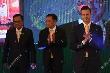 Thailand Prime Minister Prayuth Chan-ocha, left, Health Minister Anutin Charnvirakul, center, and James Teague, president of AstraZeneca's in Thailand attend a signing ceremony at Government House in Bangkok, Thailand . Thailand on Friday signed a deal to procure 26 million doses of the trial coronavirus vaccine developed by pharmaceutical firm AstraZeneca in collaboration with Oxford University