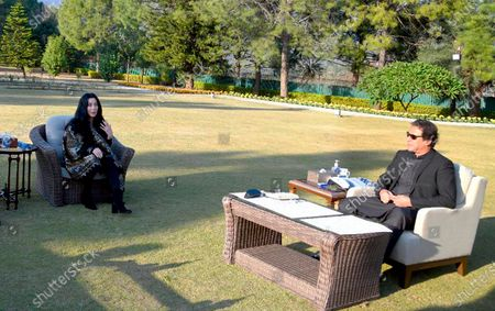 "In this photo provided by Press Information Department, U.S. Iconic singer and actress Cher, left, talks to Pakistan Prime Minister Imran Khan during their meeting, in Islamabad, Pakistan, . Cher is in Pakistan to celebrate the departure of Kaavan, dubbed the ""world's loneliest elephant,"" who will soon leave a Pakistani zoo for better conditions after years of lobbying by animal rights groups and activists"