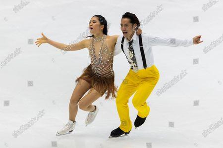 Kana Muramoto, left, and Daisuke Takahashi of Japan perform during a rhythm dance of an ISU Grand Prix of Figure Skating competition in Kadoma near Osaka, Japan