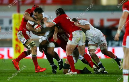Stock Picture of Billy Vunipola of England tackled by James Botham of Wales & Ryan Elias of Wales (R)