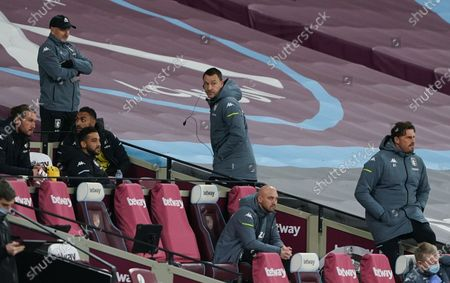 Aston Villa assistant coach John Terry walks to the stands after receiving a yellow card