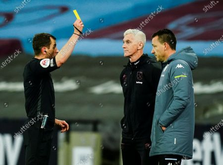 John Terry assistant head coach of Aston Villa is shown a yellow card by referee Peter Bankes