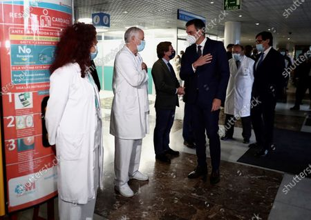 A handout photo made available by the Spanish Prime Minister's Office shows Spanish Prime Minster, Pedro Sanchez (C), during his visit to the Clinical Research and Clinical Trial Central Unit at La Paz Hospital in Madrid, Spain, 27 November 2020.