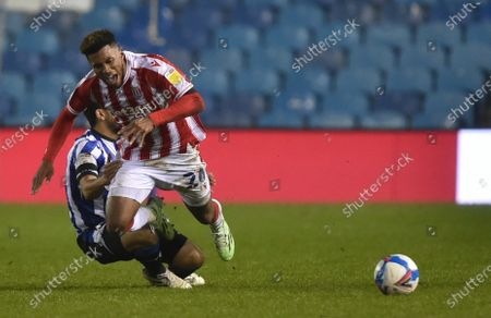 Massimo Luongo of Sheffield Wednesday fouls Tyrese Campbell of Stoke City