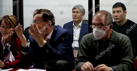 Former President of Kyrgyzstan Almazbek Atambayev(C) sits at a court hearing on the events in the village of Koy-Tash in Bishkek, Kyrgyzstan,27 November 2020. On 07 August  2019, 20 kilometers from Bishkek, in the village of Koy-Tash, the special forces of the State Committee for National Security tried to detain the politician by force in order to bring him for interrogation to the Prosecutor General's Office, as a witness. Almazbek Atambayev is charged with an article on organizing mass riots, the State Committee for National Security of Kyrgyzstan said. Almazbek Atambayev was President of Kyrgyzstan from 2011 to 2017. At the end of June 2019, parliament stripped him of his immunity.