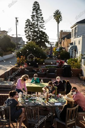 Editorial photo of People celebrate with Thanksgiving dinner outside in Hermosa Beach, CA, Walk Streets, Hermosa Beach, California, United States - 26 Nov 2020