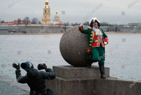 Street actor wearing costume of the Tsar Peter the Great poses for photographer with Peter and Paul fortress on the background in St. Petersburg, Russia, 27 November 2020. In the past 24 hours, Russia registered 27, 543 new cases caused by the SARS-CoV-2 coronavirus infection and 496 coronavirus-related deaths.