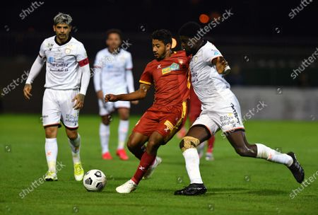 Al-Shabab's player Alfred N'Diaye (R) in action against Damac's Mohmad Atiah (C) during the Saudi Professional League soccer match between Al-Shabab and Damac at Prince Khalid bin Sultan Stadium, in Riyadh, Saudi Arabia, 27 November 2020.