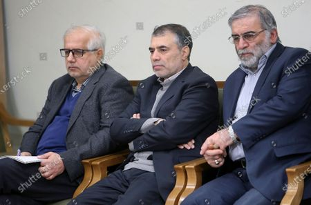 In this picture released by the official website of the office of the Iranian supreme leader, Mohsen Fakhrizadeh, right, sits in a meeting with Supreme Leader Ayatollah Ali Khamenei in Tehran, Iran, Jan. 23, 2019. Fakhrizadeh, an Iranian scientist that Israel alleged led the Islamic Republic's military nuclear program until its disbanding in the early 2000s was killed in a targeted attack that saw gunmen use explosives and machine gun fire, state television said. Two others are unidentified