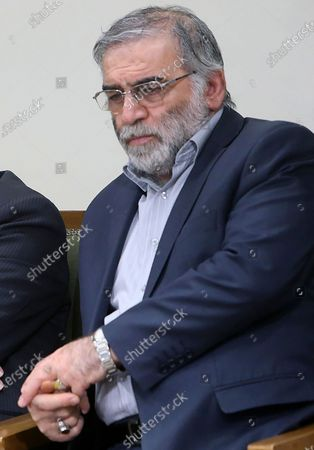 Stock Picture of In this picture released by the official website of the office of the Iranian supreme leader, Mohsen Fakhrizadeh sits in a meeting with Supreme Leader Ayatollah Ali Khamenei in Tehran, Iran, Jan. 23, 2019. Fakhrizadeh, an Iranian scientist that Israel alleged led the Islamic Republic's military nuclear program until its disbanding in the early 2000s was killed in a targeted attack that saw gunmen use explosives and machine gun fire, state television said. Two others are unidentified