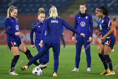 Stock Picture of Substitue player United States' Alex Morgan, second right, warms up with other players prior to the international friendly women's soccer match between The Netherlands and the US at the Rat Verlegh stadium in Breda, southern Netherlands