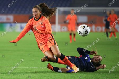 United States' Kelley O'Hara tackles Netherlands' Lieke Martens, left, during the international friendly women's soccer match between The Netherlands and the US at the Rat Verlegh stadium in Breda, southern Netherlands
