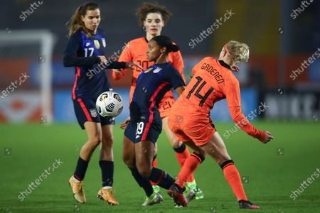United States' Crystal Dunn, center, and Tobin Heath, left, and Netherlands' Jackie Groenen, right, and Dominique Janssen, rear, vie for the ball during the international friendly women's soccer match between The Netherlands and the US at the Rat Verlegh stadium in Breda, southern Netherlands