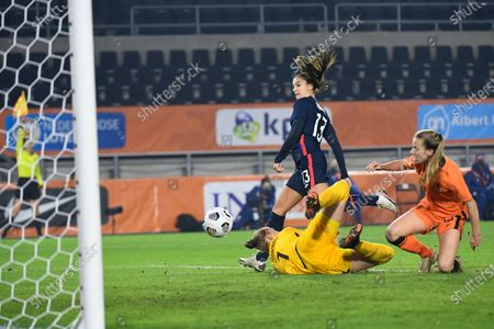 United States Alex Morgan, center in blue, tips the ball into the goal passing Netherlands' goalkeeper Sari Van Veenendaal during the international friendly women's soccer match between The Netherlands and the US at the Rat Verlegh stadium in Breda, southern Netherlands, . The goal was disallowed for offside, lineswomen signaling left