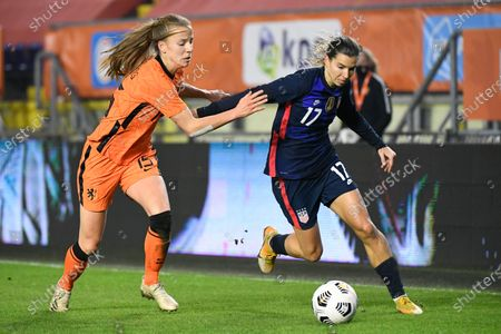 United States' Tobin Heath, right, and Netherlands' Lynn Wilms vie for the ball during the international friendly women's soccer match between The Netherlands and the US at the Rat Verlegh stadium in Breda, southern Netherlands