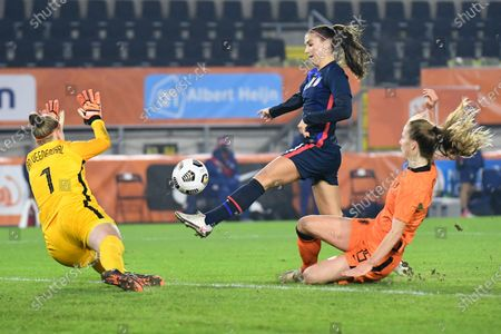 Stock Image of United States Alex Morgan, center in blue, tips the ball into the goal passing Netherlands' goalkeeper Sari Van Veenendaal, left, during the international friendly women's soccer match between The Netherlands and the US at the Rat Verlegh stadium in Breda, southern Netherlands, . The goal was disallowed for offside
