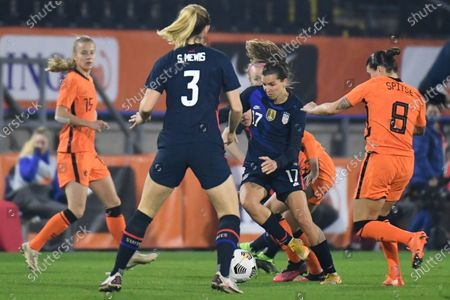 United States' Tobin Heath, second right and Netherlands' Sherida Spitse, right, vie for the ball during the international friendly women's soccer match between The Netherlands and the US at the Rat Verlegh stadium in Breda, southern Netherlands