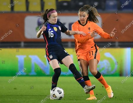 United States' Rose Lavelle, left, and Netherlands' Lieke Martens vie for the ball during the international friendly women's soccer match between The Netherlands and the US at the Rat Verlegh stadium in Breda, southern Netherlands