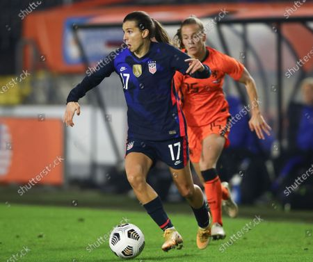 United States' Tobin Heath, left, and Netherlands' Lynn Wilms vie for the ball during the international friendly women's soccer match between The Netherlands and the US at the Rat Verlegh stadium in Breda, southern Netherlands