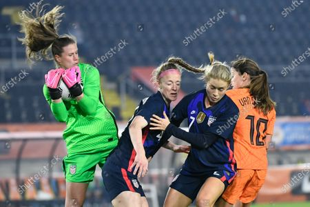 United States' goalkeeper Alyssa Naeher saves as teammates Becky Sauerbrunn, second left, and Abby Dahlkemper, second right, block Netherlands' Danielle van de Donk, right, during the international friendly women's soccer match between The Netherlands and the US at the Rat Verlegh stadium in Breda, southern Netherlands