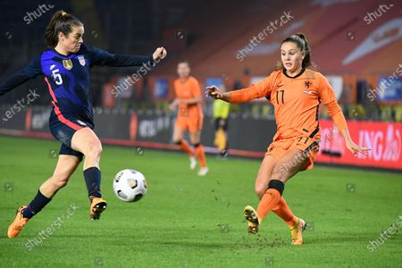 Stock Image of United States' Kelley O'Hara, left, tries to block a shot by Netherlands' Lieke Martens, right, during the international friendly women's soccer match between The Netherlands and the US at the Rat Verlegh stadium in Breda, southern Netherlands